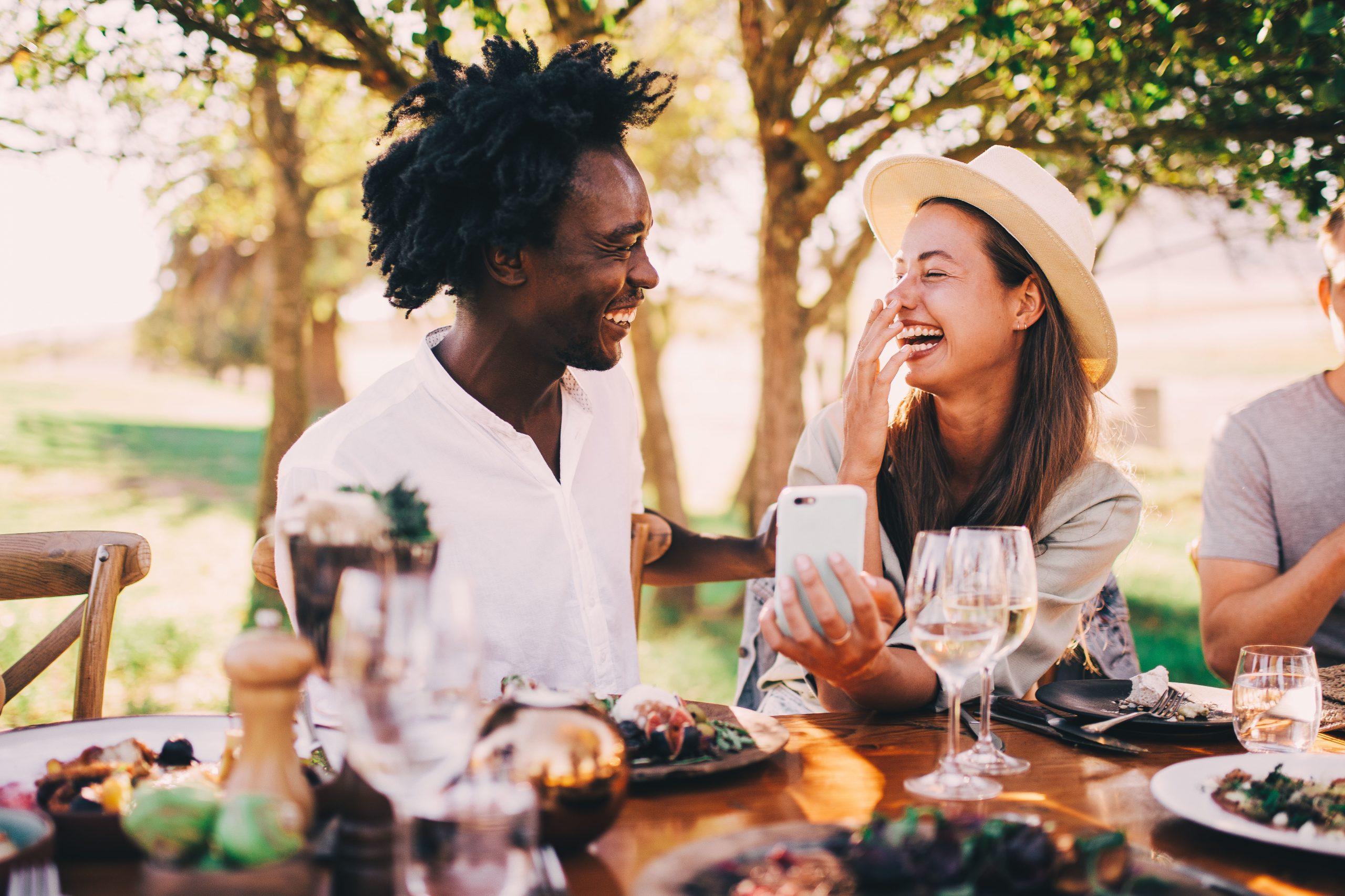 couple having a picnic having fun